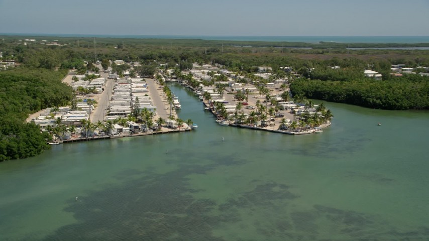 5K stock footage aerial video of flying by Calusa Camp Resort by Buttonwood Sound, Key Largo, Florida Aerial Stock Footage | AX0025_066