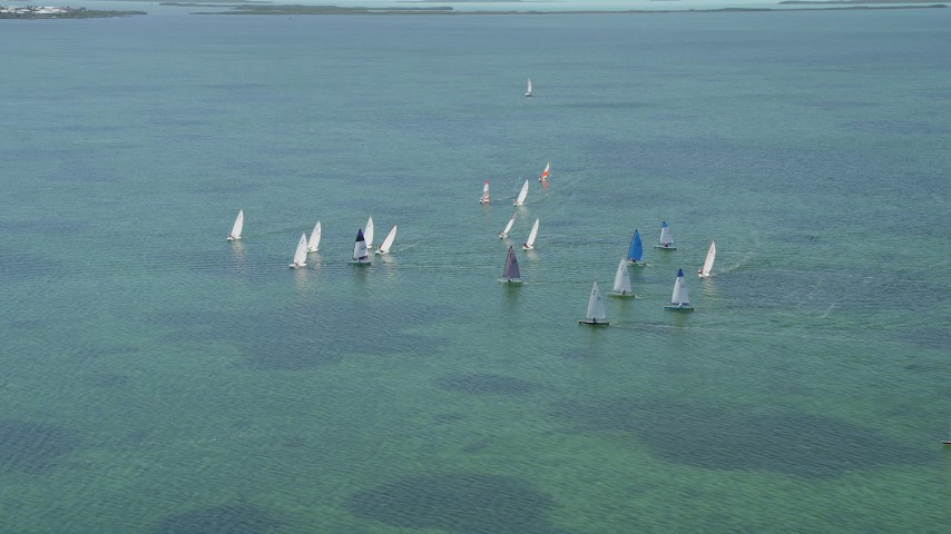 5K stock footage aerial video of flying by sailboats on Buttonwood Sound, Key Largo, Florida Aerial Stock Footage | AX0025_067