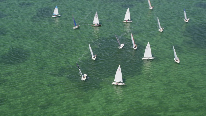 5K stock footage aerial video of flying by sailboats on Buttonwood Sound, Key Largo, Florida Aerial Stock Footage | AX0025_068