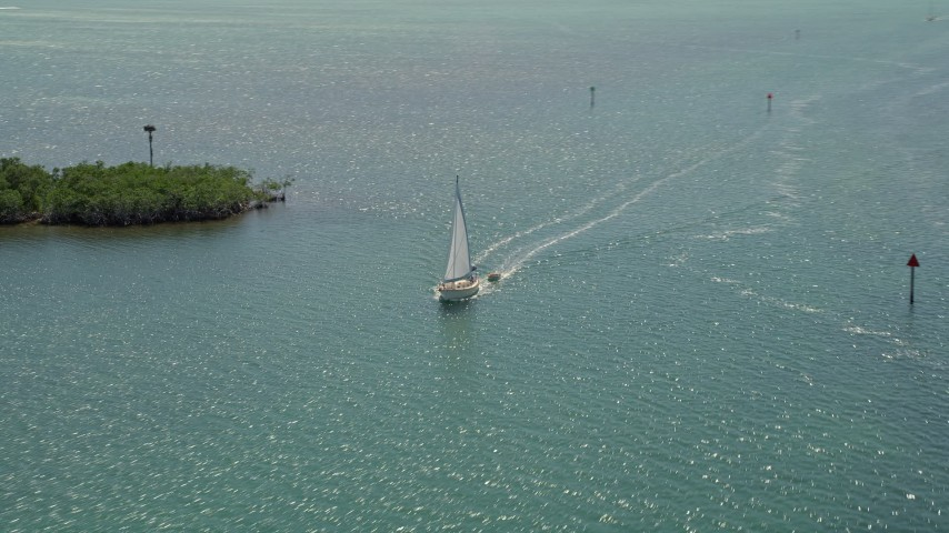 5K stock footage aerial video of flying by a sailboat in Buttonwood Sound, Key Largo, Florida Aerial Stock Footage | AX0025_071