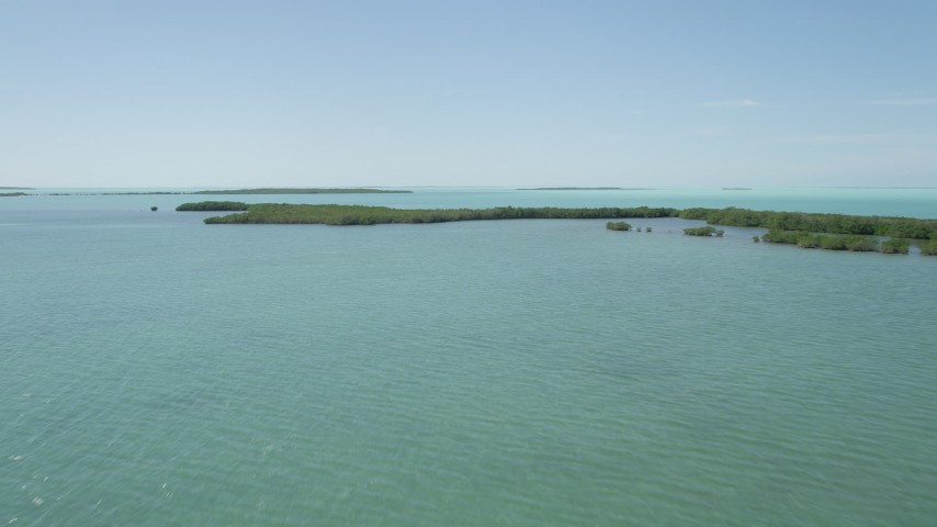 5K stock footage aerial video of approaching mangroves off the shore, Key Largo, Florida Aerial Stock Footage | AX0025_073