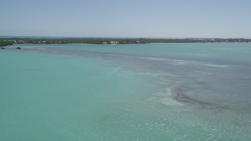 5K stock footage aerial video of approaching a home on the shore, Tavernier, Florida Aerial Stock Footage | AX0025_083