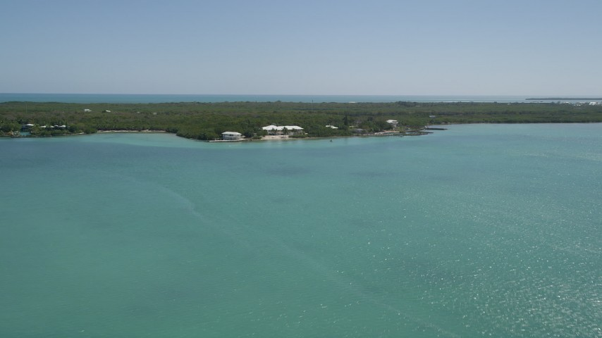 5K stock footage aerial video of approaching a home on the shore, Tavernier, Florida Aerial Stock Footage | AX0025_084
