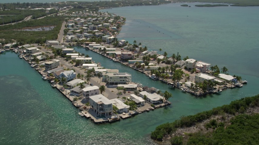 5K aerial stock footage video of flying over homes on the shore, Tavernier, Florida Aerial Stock Footage | AX0025_086