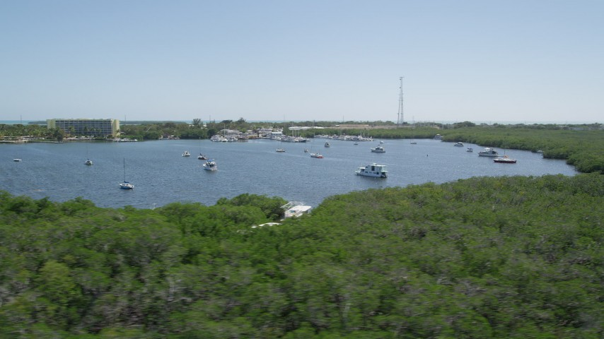 5K stock footage aerial video of flying by sailboats and fishing boats off the shore, Tavernier, Florida Aerial Stock Footage | AX0025_089