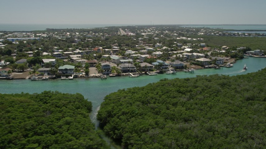 5K stock footage aerial video of flying low over mangroves toward Tavernier Creek homes, Tavernier, Florida Aerial Stock Footage | AX0025_090