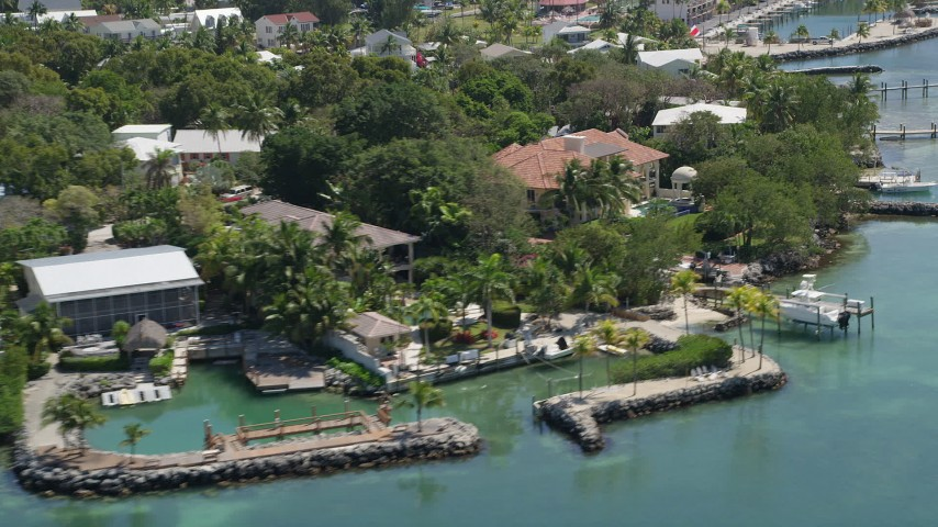 5K stock footage aerial video of flying by a mansion on the shore, Tavernier, Florida Aerial Stock Footage | AX0025_101