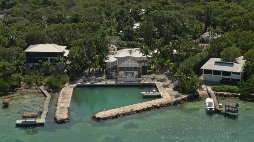 5K stock footage aerial video of homes with docks on the shore, Tavernier, Florida Aerial Stock Footage | AX0025_102