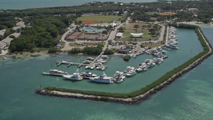 5K stock footage aerial video of flying by fishing boats docked, Plantation Yacht Harbor Resort, Islamorada, Florida Aerial Stock Footage   AX0025_103