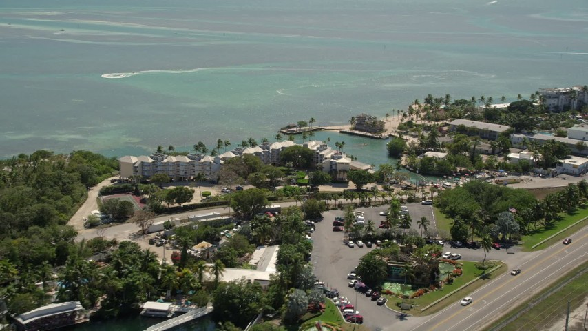 5K stock footage aerial video of flying by the coastal Holiday Isle Resort and Marina, Islamorada, Florida Aerial Stock Footage | AX0025_108
