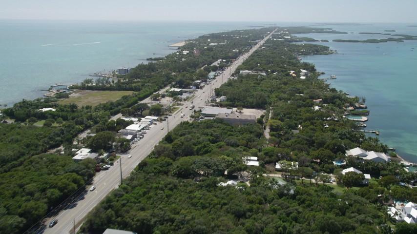 5K stock footage aerial video of following Overseas Highway, revealing Upper Matecumbe Key, Islamorada, Florida Aerial Stock Footage | AX0025_110