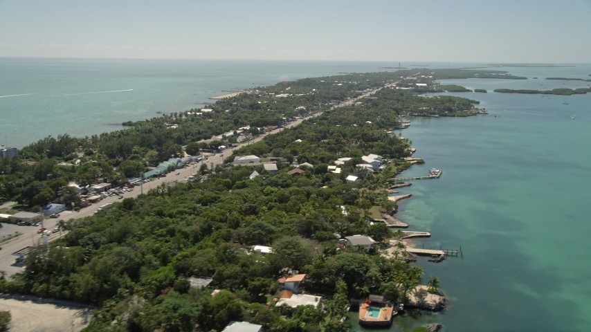 5K stock footage aerial video of following Overseas Highway, revealing Upper Matecumbe Key, Islamorada, Florida Aerial Stock Footage | AX0025_110E
