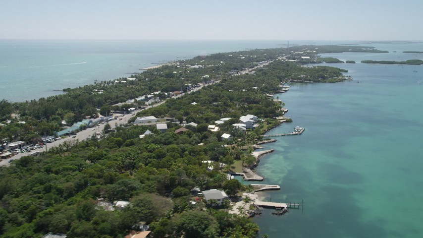 5K aerial video of flying by homes along the shore, Islamorada, Florida Aerial Stock Footage | AX0025_111