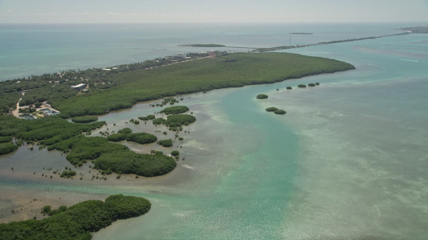 5K stock footage aerial video of following a dredge to approach mangroves near coast, Islamorada, Florida Aerial Stock Footage | AX0025_116