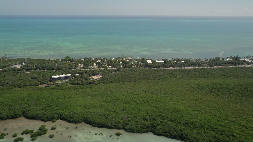 5K stock footage aerial video of flying by Resorts and Marinas along the shore, Islamorada, Florida Aerial Stock Footage | AX0025_117