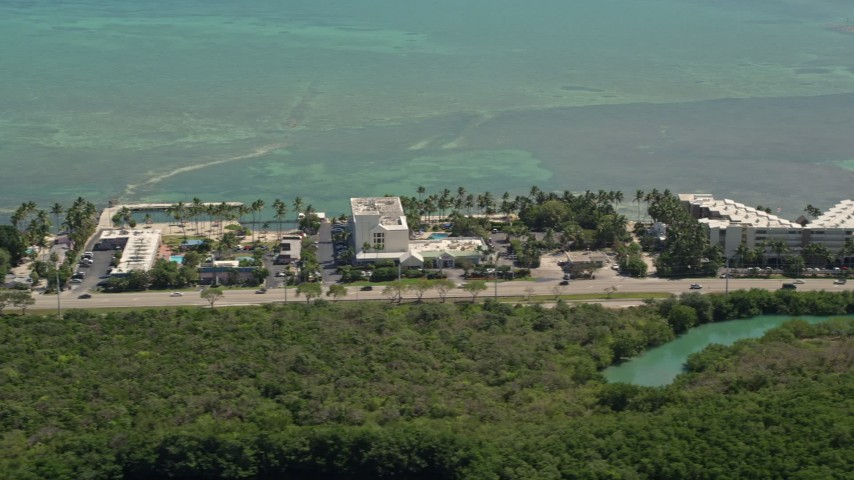5K stock footage aerial video of flying by Breezy Palms Resort, Hampton Inn and Suites, Islamorada, Florida Aerial Stock Footage | AX0025_118