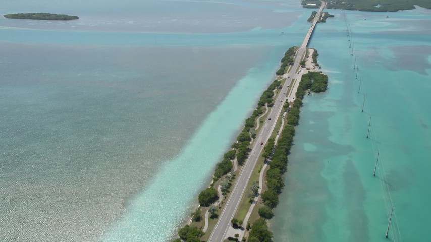 5K aerial video follow Overseas Highway, approach Lower Matecumbe Key, Islamorada, Florida Aerial Stock Footage AX0025_120