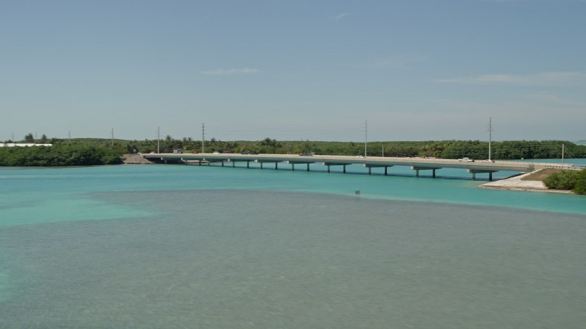 5K stock footage aerial video of flying by a bridge on the Overseas Highway, Islamorada, Florida Aerial Stock Footage | AX0025_123
