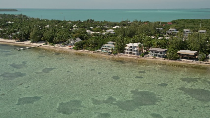 5K stock footage aerial video of oceanfront homes on the coast in Islamorada, Florida Aerial Stock Footage | AX0025_125