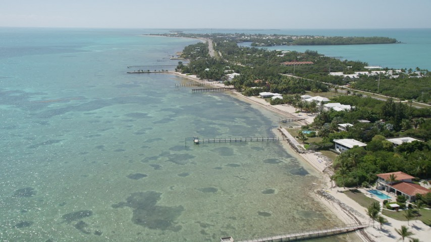 5K aerial video of flying by homes on the coast, Islamorada, Florida Aerial Stock Footage | AX0025_126