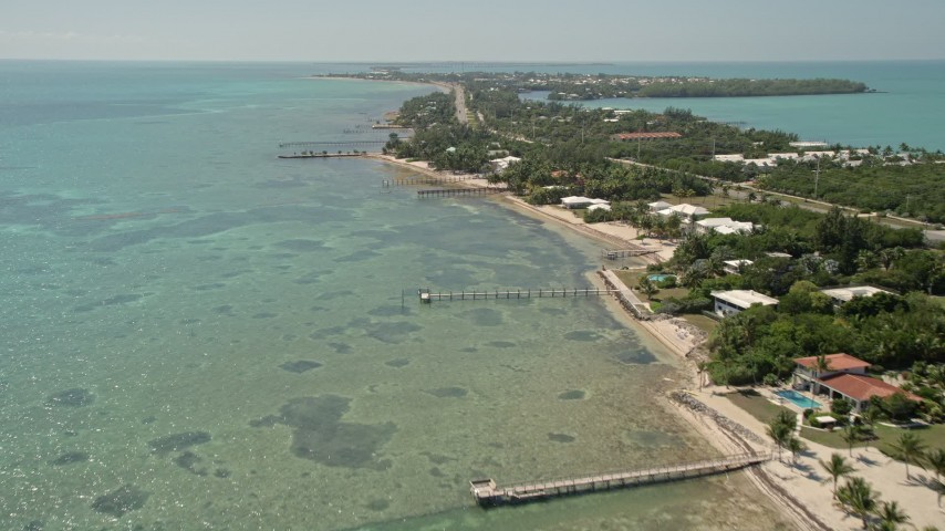 5K stock footage aerial video of flying by homes on the coast, Islamorada, Florida Aerial Stock Footage | AX0025_126E