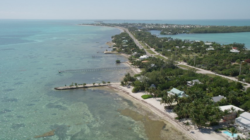 5K aerial video of homes with docks on the coast, Islamorada, Florida Aerial Stock Footage | AX0025_127