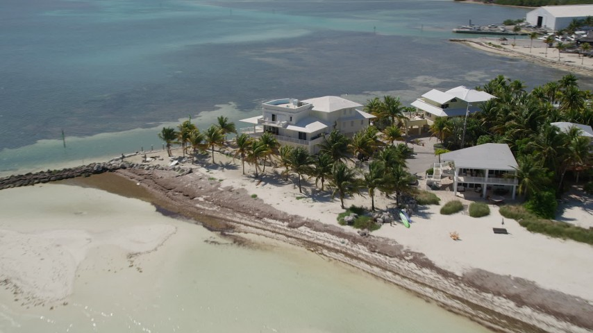 5K stock footage aerial video of a spacial home on the beach in Islamorada, Florida Aerial Stock Footage | AX0025_131