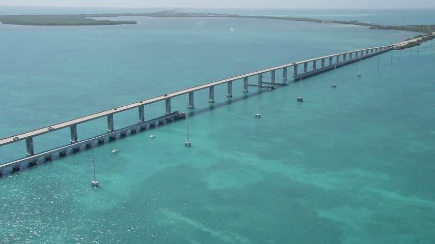 5K stock footage aerial video of approaching Overseas Highway bridge to Fiesta Key, Florida Aerial Stock Footage | AX0025_135