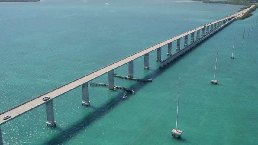 5K stock footage aerial video of flying toward Overseas Highway bridge to Fiesta Key, Florida Aerial Stock Footage | AX0025_136