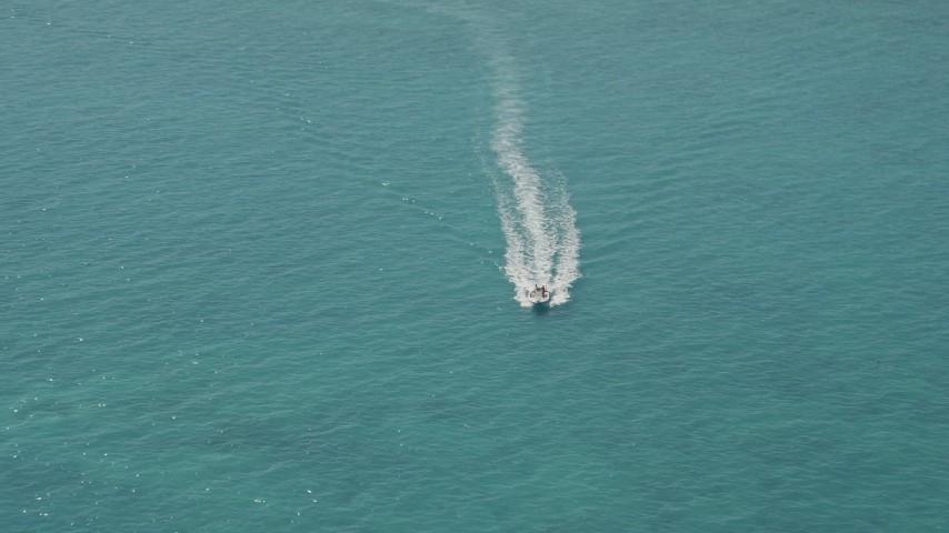 5K stock footage aerial video approach speedboat near Overseas Highway, Conch Key, Marathon, Florida Aerial Stock Footage | AX0025_144