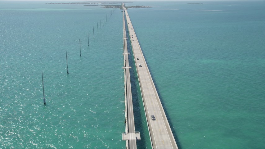 5K stock footage aerial video of following Overseas Highway to Conch Key, Marathon, Florida Aerial Stock Footage | AX0025_145