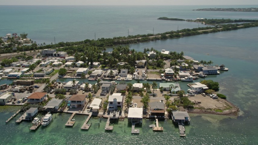 5K stock footage aerial video of flying by small neighborhood on Conch Key, Marathon, Florida Aerial Stock Footage | AX0025_147