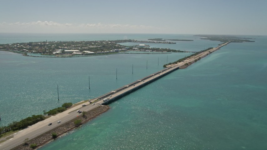 5K stock footage aerial video of following Overseas Highway by Duck Key, Marathon, Florida Aerial Stock Footage | AX0025_149