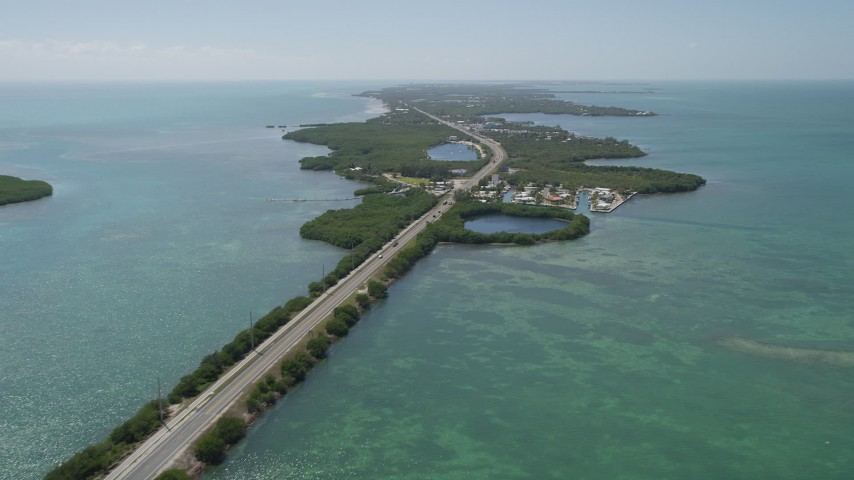 5K stock footage aerial video of flying by Overseas Highway, pan right to reveal Grassy Key, Marathon, Florida Aerial Stock Footage | AX0025_151