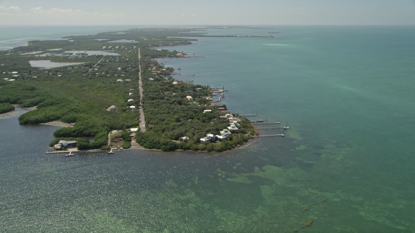 5K stock footage aerial video of approaching homes on the shore of Grassy Key, Marathon, Florida Aerial Stock Footage | AX0025_154