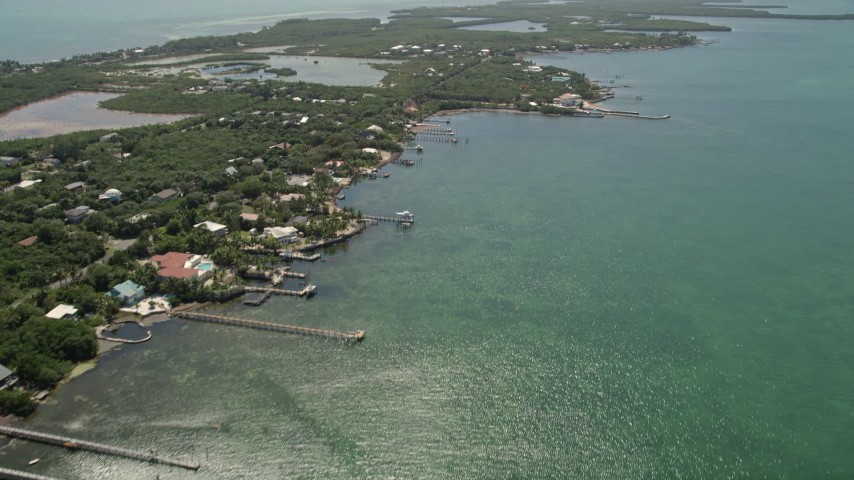 5K stock footage aerial video fly by homes on shore of Grassy Key, Marathon, Florida Aerial Stock Footage | AX0025_155