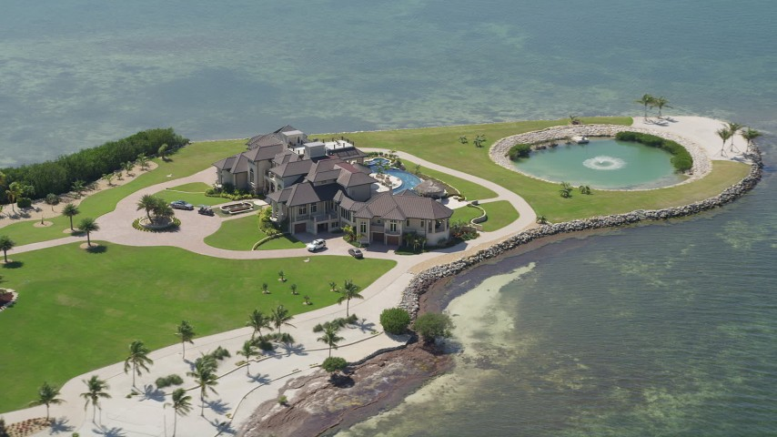 5K stock footage aerial video of orbiting mansion on Long Point Key, Marathon, Florida Aerial Stock Footage AX0025_158 | Axiom Images