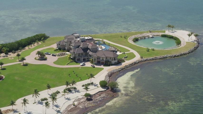 5K stock footage aerial video of orbiting mansion on Long Point Key, Marathon, Florida Aerial Stock Footage AX0025_158