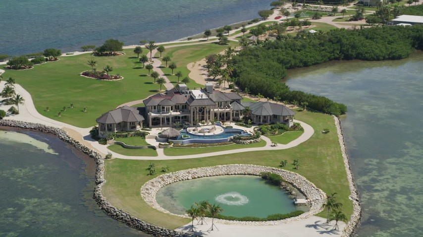 5K stock footage aerial video of a mansion on Long Point Key, Marathon, Florida Aerial Stock Footage AX0025_159