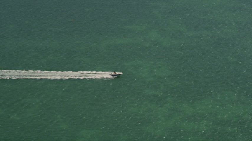 5K stock footage aerial video of tracking speedboat off shore of Fat Deer Key, Marathon, Florida Aerial Stock Footage | AX0025_163