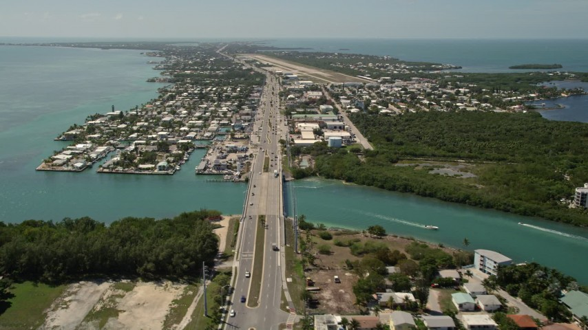5K stock footage aerial video of the Overseas Highway and Florida Keys Marathon Airport, Marathon, Florida Aerial Stock Footage | AX0025_164