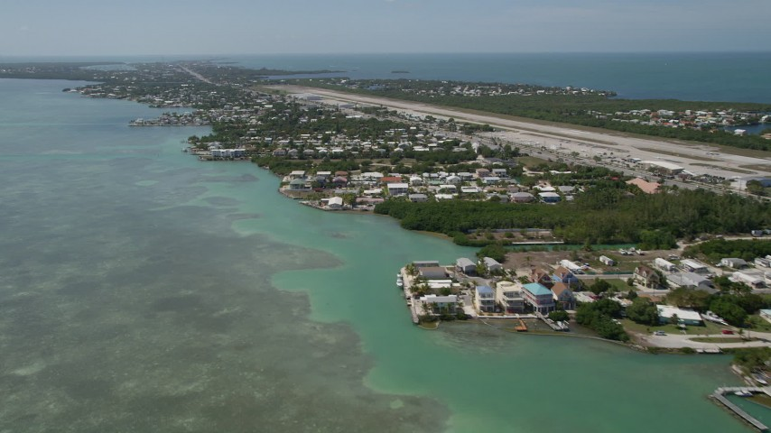 5K stock footage aerial video of flying by neighborhoods near Florida Keys Marathon Airport, Marathon, Florida Aerial Stock Footage | AX0025_165