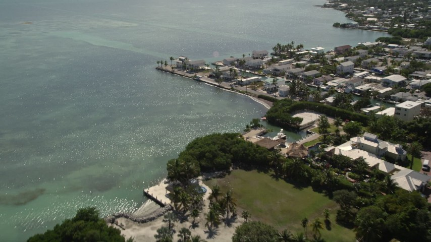 5K stock footage aerial video of approaching coastal homes by the water, Marathon, Florida Aerial Stock Footage | AX0026_003