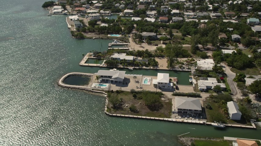 5K stock footage aerial video of flying over oceanfront homes in Marathon, Florida Aerial Stock Footage | AX0026_005