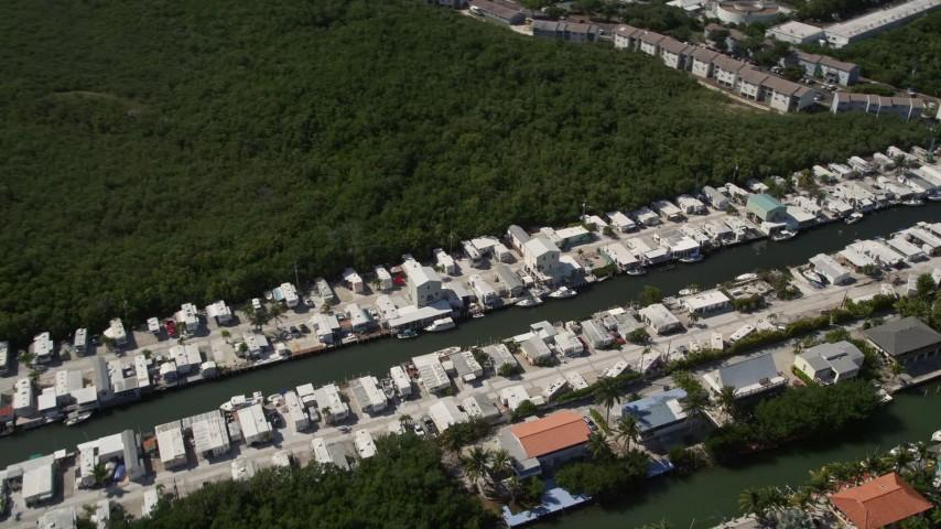 5K stock footage aerial video of homes on coastal canal, Marathon, Florida Aerial Stock Footage | AX0026_007