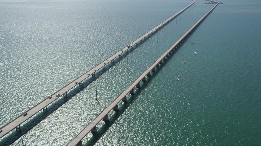 5K stock footage aerial video of tracking light traffic on the Seven Mile Bridge, Marathon, Florida Aerial Stock Footage | AX0026_016