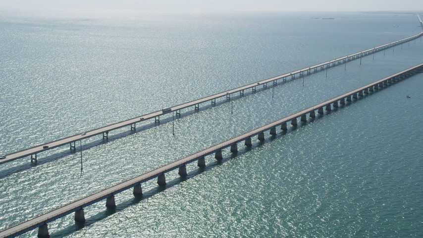 5K stock footage aerial video of approaching light traffic on the Seven Mile Bridge, Florida Aerial Stock Footage | AX0026_017
