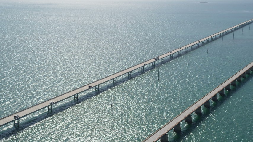 5K stock footage aerial video of cars driving on the Seven Mile Bridge, Florida Aerial Stock Footage | AX0026_018