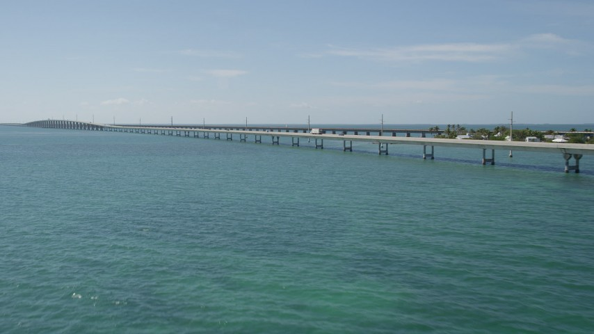 5K stock footage aerial video of flying by light traffic on the Seven Mile Bridge, Florida Aerial Stock Footage | AX0026_021