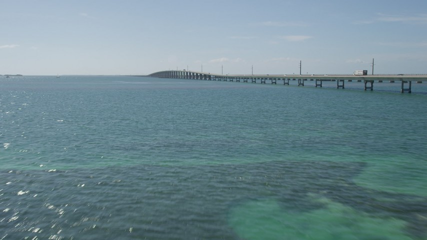 5K stock footage aerial video of approaching light traffic on Seven Mile Bridge, Florida Aerial Stock Footage | AX0026_022